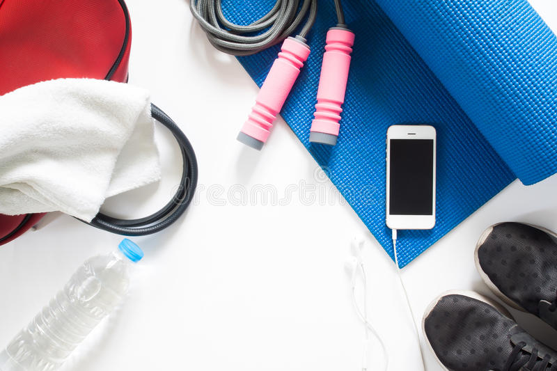 Overhead view of sport equipment, jumping rope, bottle of water royalty free stock photography