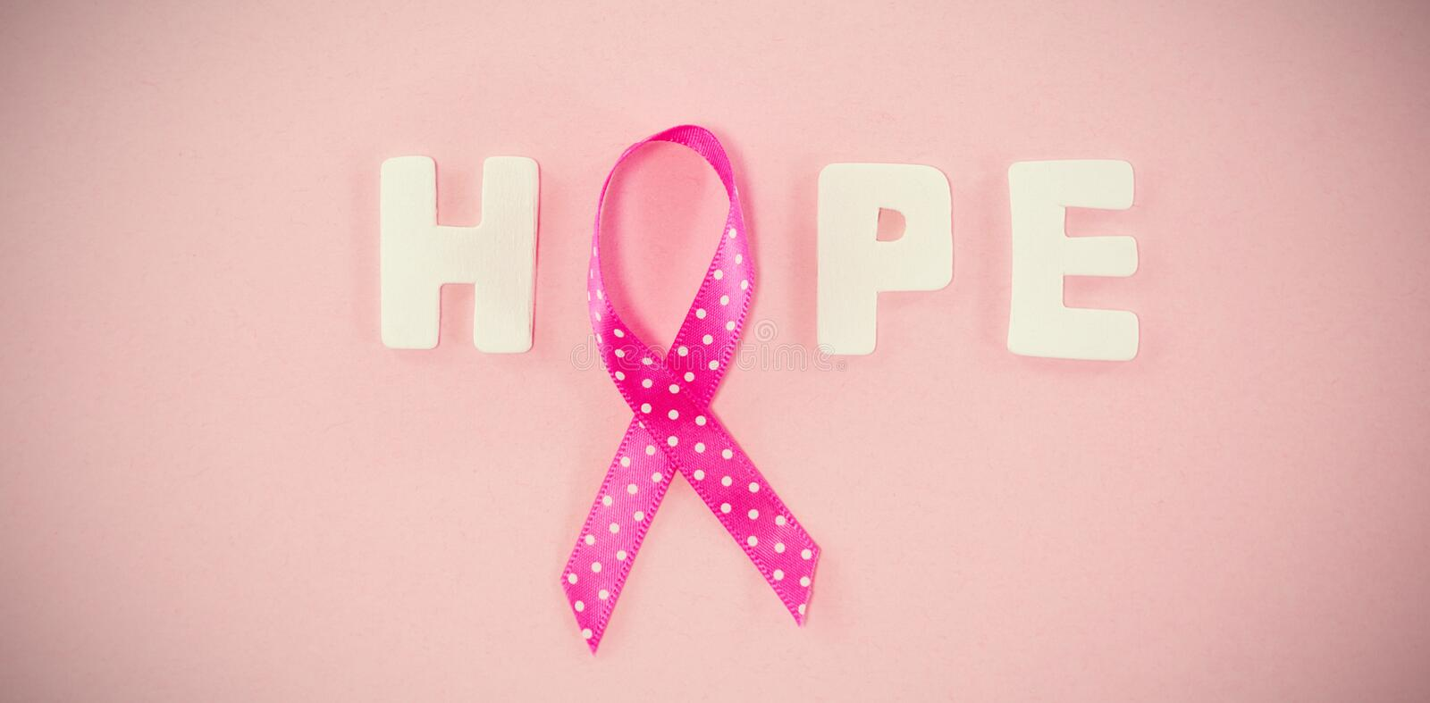 Overhead view of spotted Breast Cancer Awareness ribbon with HOPE text stock image