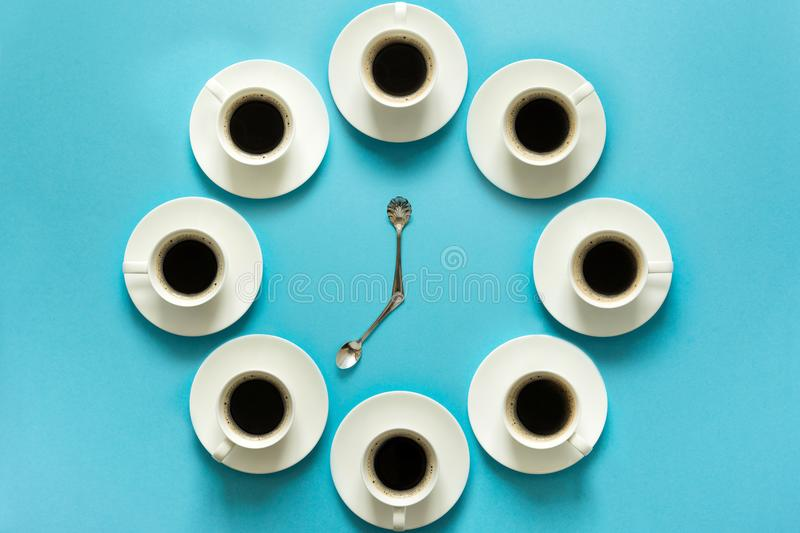 Overhead view of the steps in drinking a cup of fresh espresso. Coffee clock. Art food. Good morning concept stock image