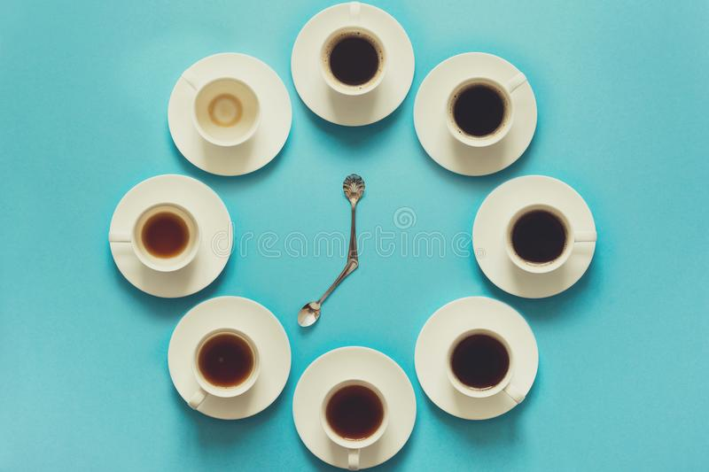 Overhead view of the steps in drinking a cup of fresh espresso. Coffee clock. Art food. Good morning concept. Toned royalty free stock photography
