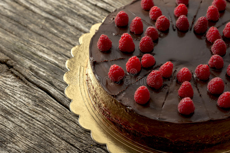 Overhead view of tasty raw chocolate cake decorated with raspber royalty free stock photography