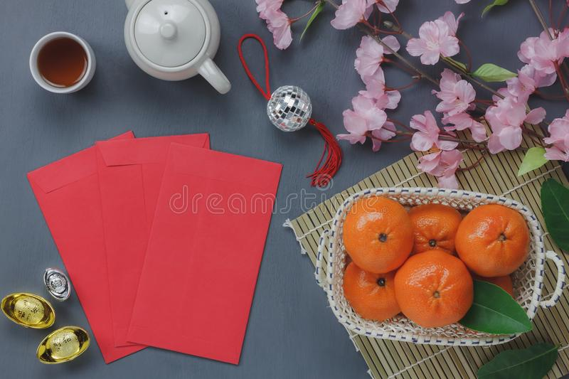 Overhead view of top essential items Happy Chinese new years. Other language means wealthy or rich and happiness.Mix several objects on modern grey wooden home royalty free stock images