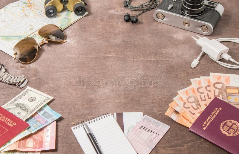 Overhead view of Traveler`s accessories, Passports and banknotes. Travel concept on wooden background. Space for text royalty free stock photos