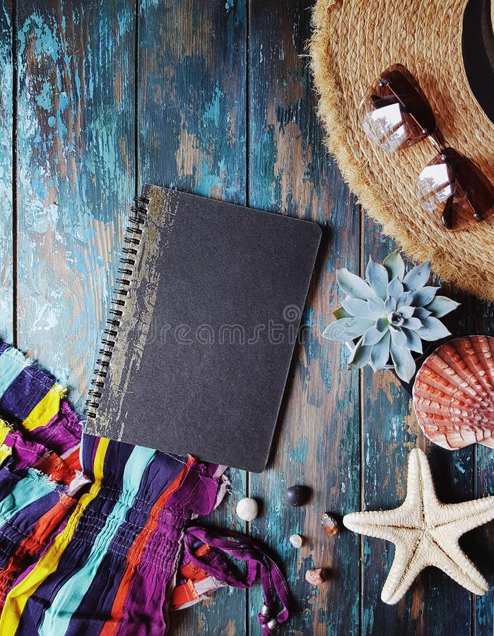 Overhead view of vacation accessories on tustic wooden table, travel planing concept. Trip without baggage, traveller lifestyle, holiday, summer, plane, camera stock photo