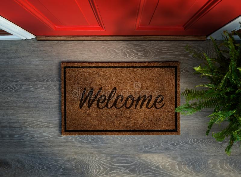 Overhead view of welcome mat outside inviting front door stock images