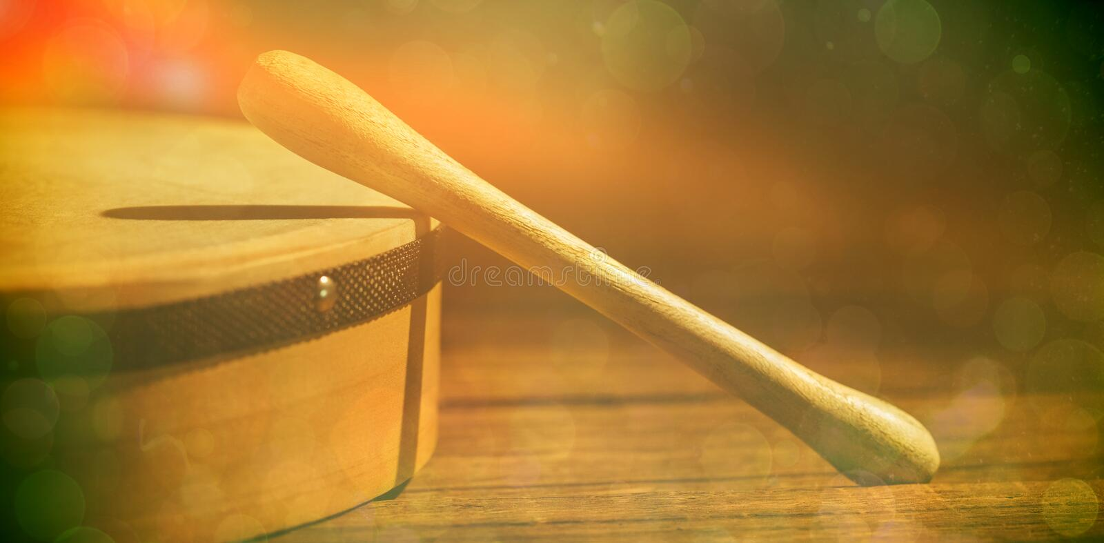 Cropped image of wooden bodhran with stick stock photo