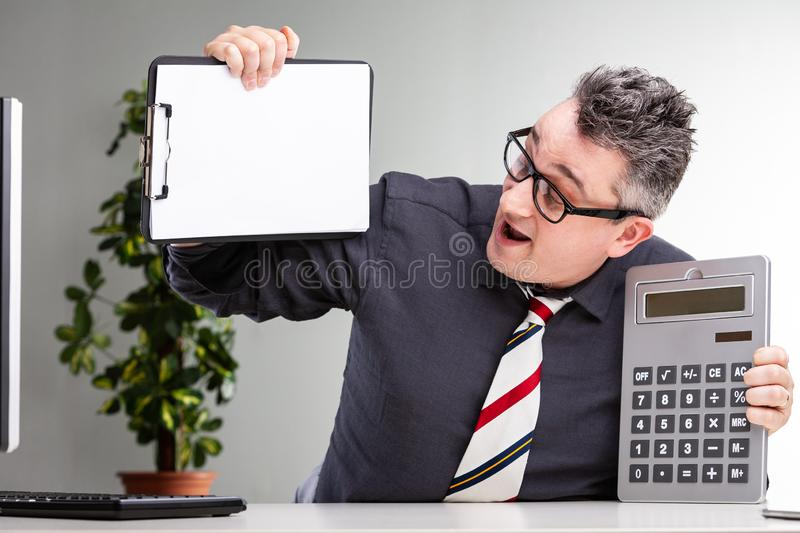 Overjoyed businessman showing off his finances royalty free stock image