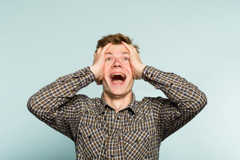 Overjoyed happy excited man clutching head emotion royalty free stock photo
