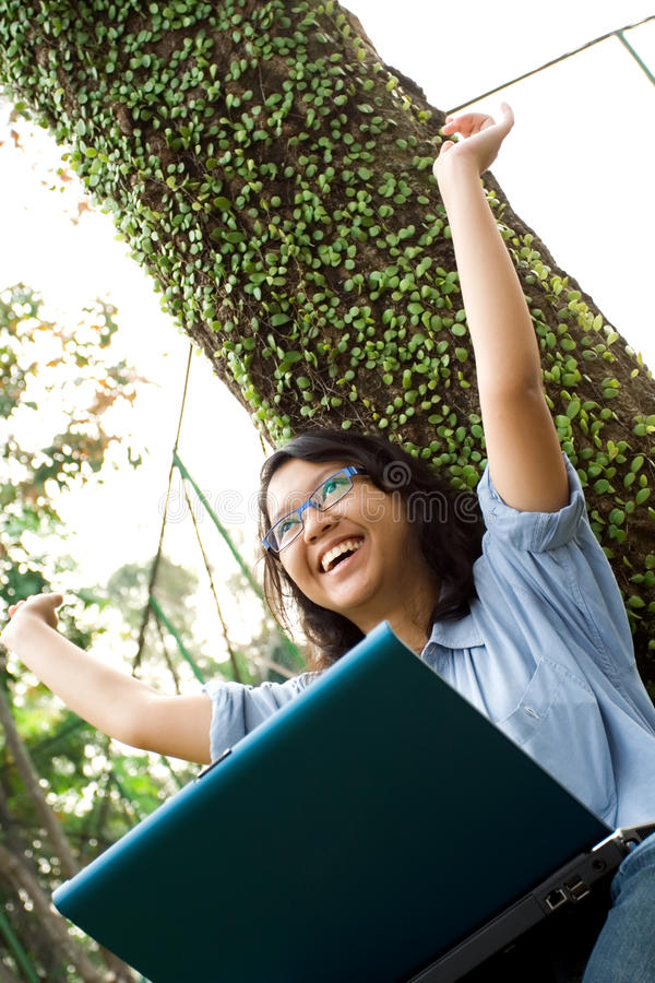 Overjoyed female college student stock image