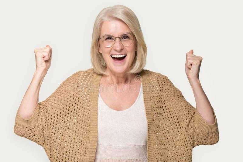 Overjoyed mature woman feel euphoric with good news royalty free stock image