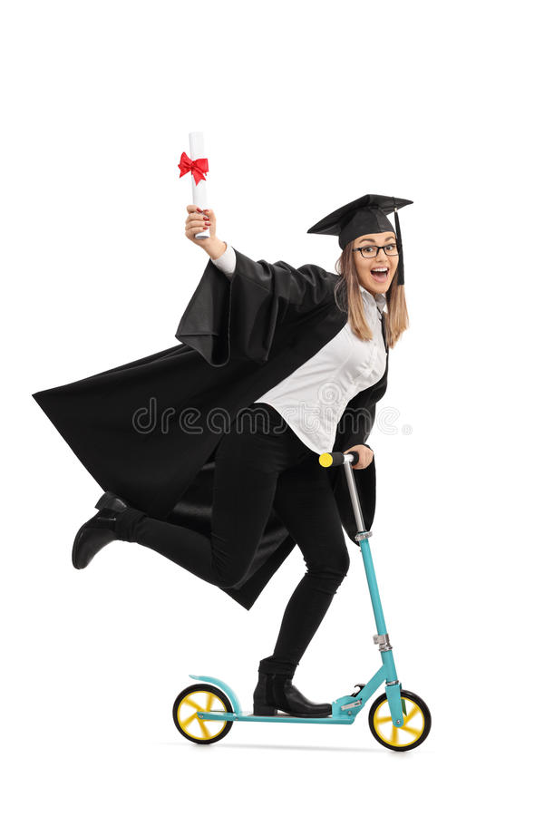 Overjoyed graduate student holding a diploma and riding a scooter royalty free stock images