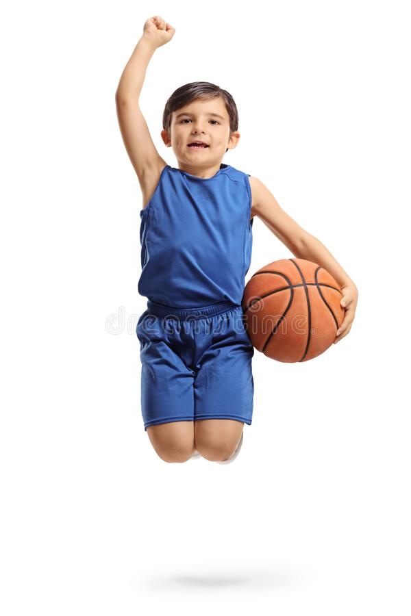 Overjoyed little basketball player jumping and gesturing happiness royalty free stock photos