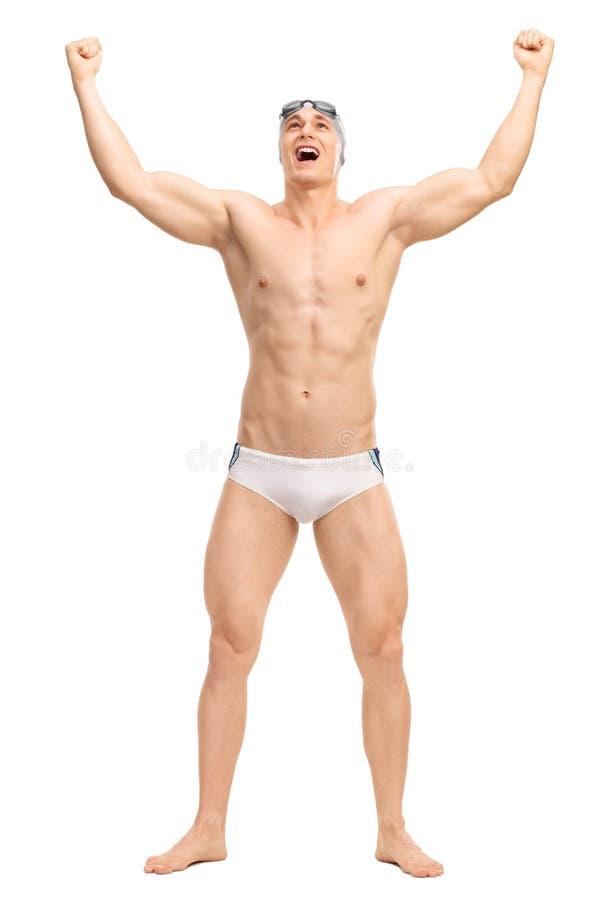 Overjoyed male swimmer celebrating victory. Full length portrait of an overjoyed male swimmer in white swim trunks celebrating victory isolated on white stock images