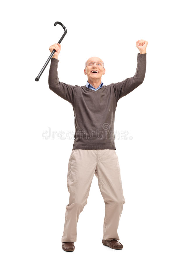 Overjoyed senior holding a cane an looking up stock photo