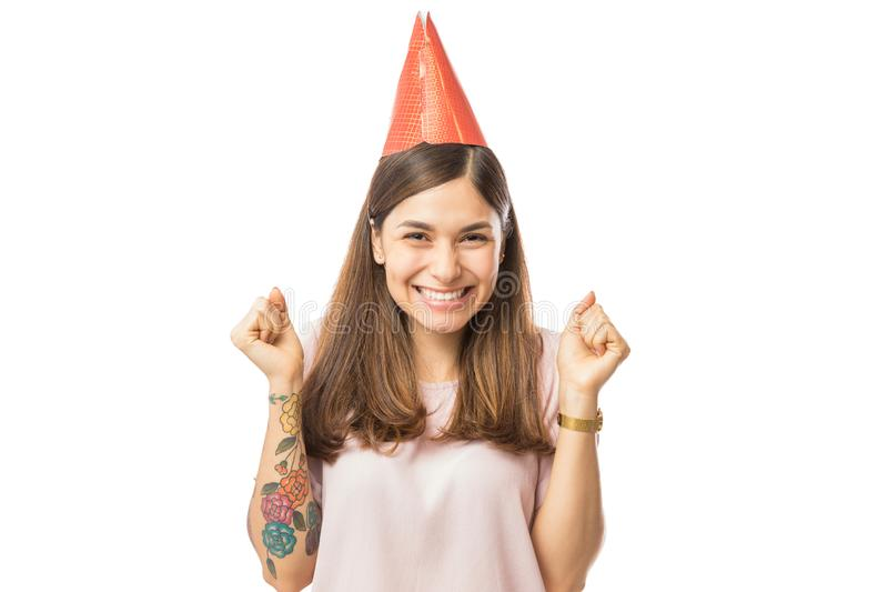 Overjoyed Young Female Wearing Birthday Hat. Against white background stock photos