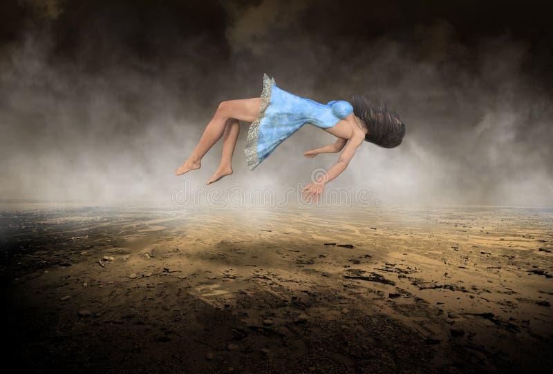 Overkligt sväva, fallande kvinna, ödelägger öknen royaltyfri foto