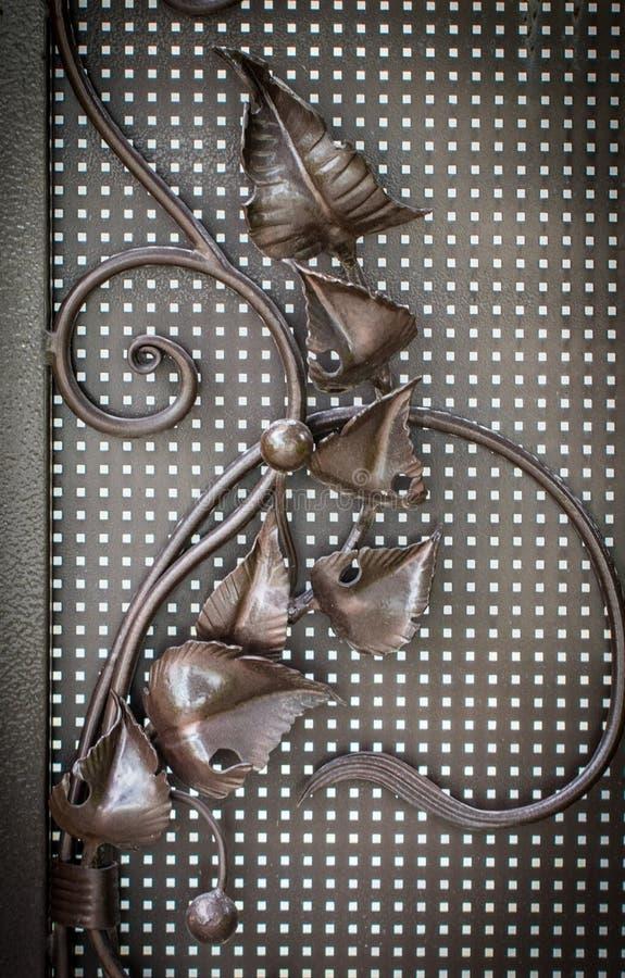 Overladen smeedijzerelementen van de decoratie van de metaalpoort royalty-vrije stock foto