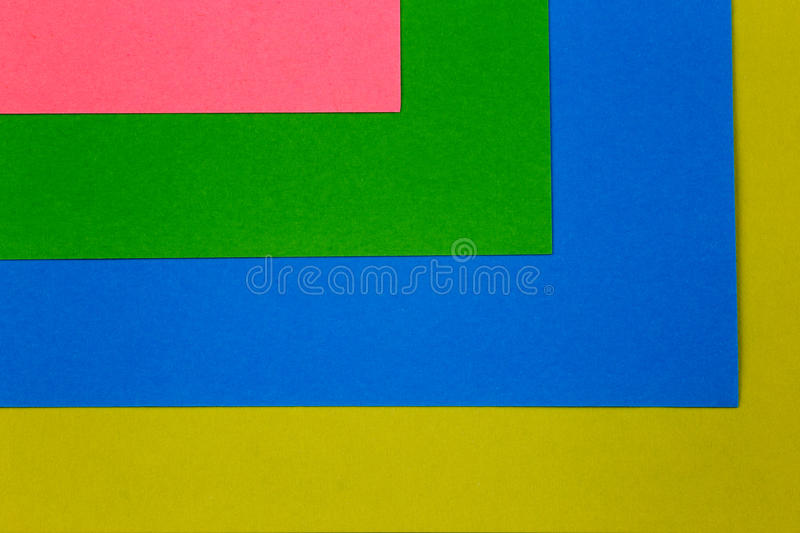 Overlaid Coloured Paper Card Sheet Stack. Overlaid stack of coloured paper card sheets royalty free stock photo