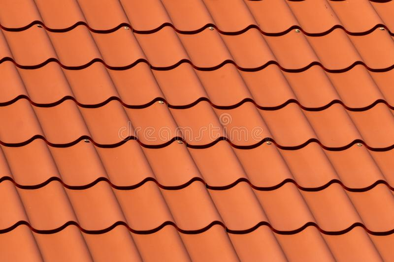 Overlapping rows of red tiles roof in Estonia royalty free stock photos