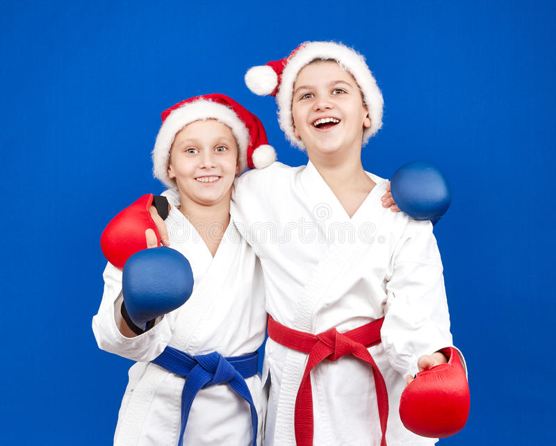 With overlays on their hands and in hats Santa's athletes are smiling stock image