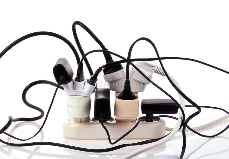 Overload. Electrical power strip overloaded with many plugs stock images