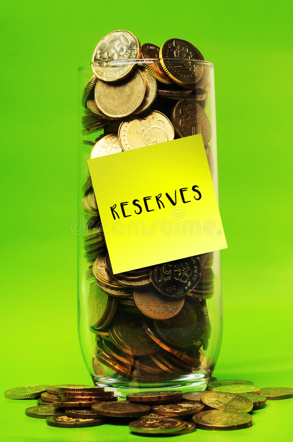 Overload coins in glass with sticky notes reserves royalty free stock images