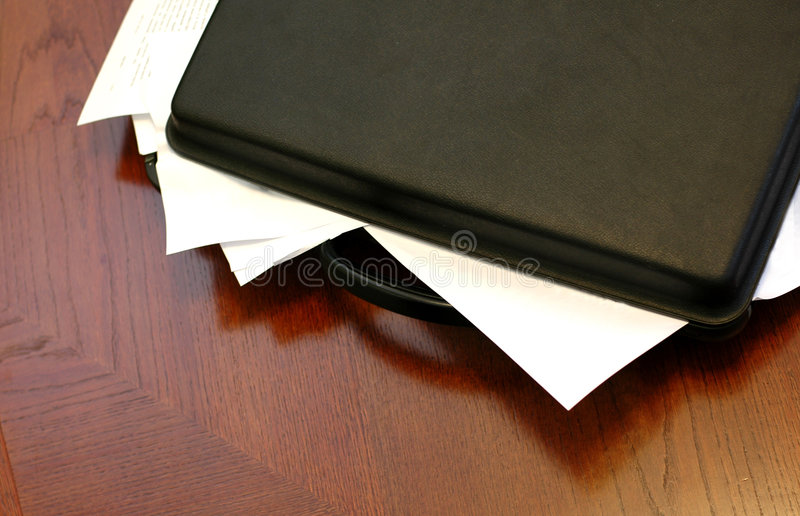 Overloaded briefcase stock images