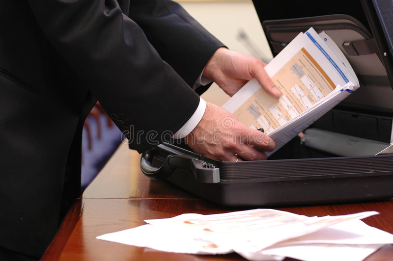 Overloaded business briefcase stock photos