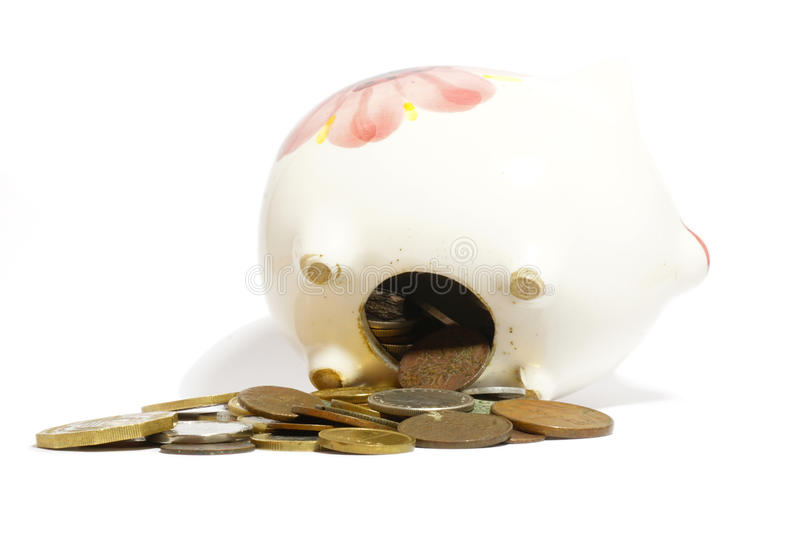 Overloaded piggy bank and coins royalty free stock photography