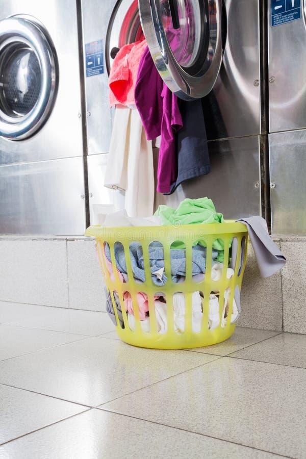 Overloaded Washing Machine And Laundry Basket Stock Image