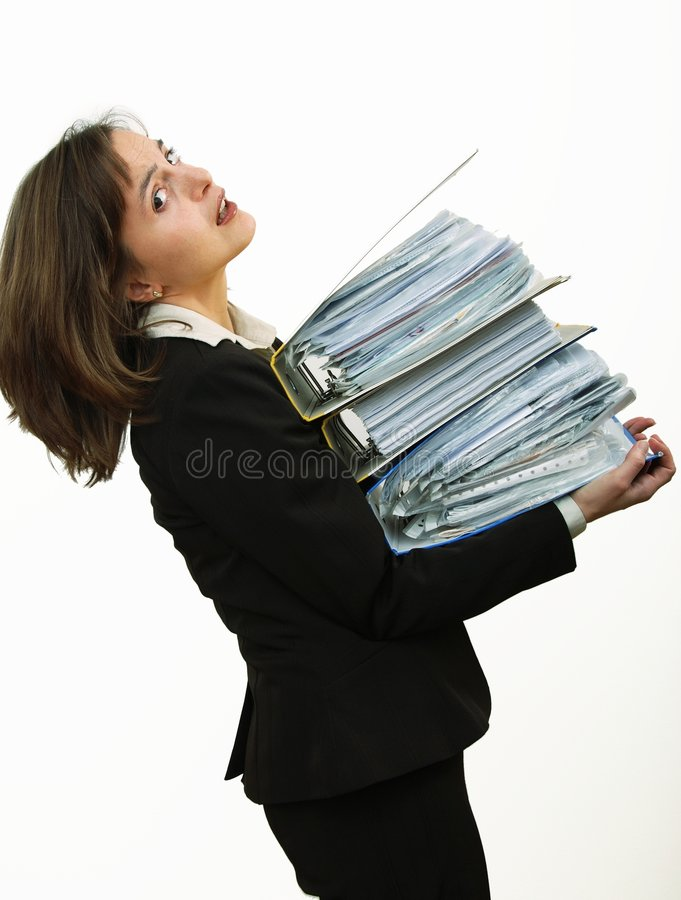 Overloaded? Woman With Heavy Files Royalty Free Stock Images