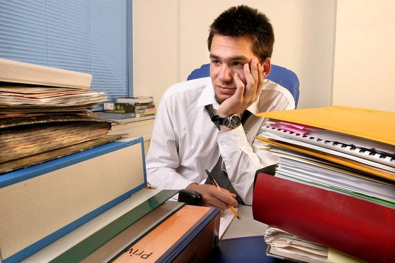Download Overloaded with work stock photo. Image of paper, books - 1688208
