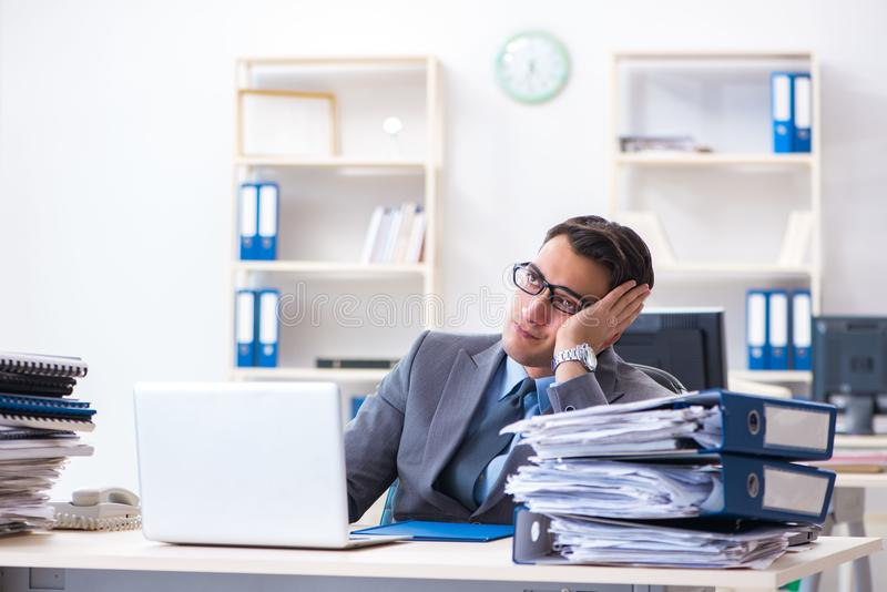 The overloaded with work employee under paperwork burden stock images