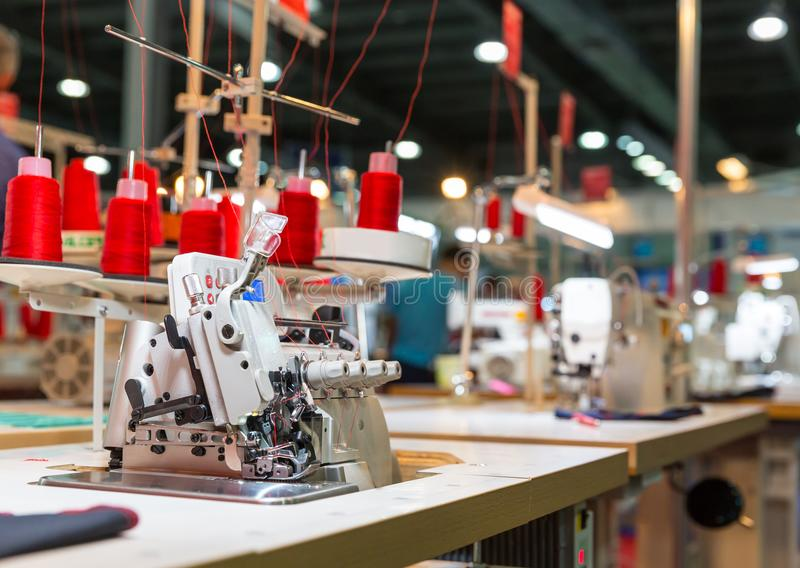 Overlock machine on sewing factory, nobody royalty free stock photography