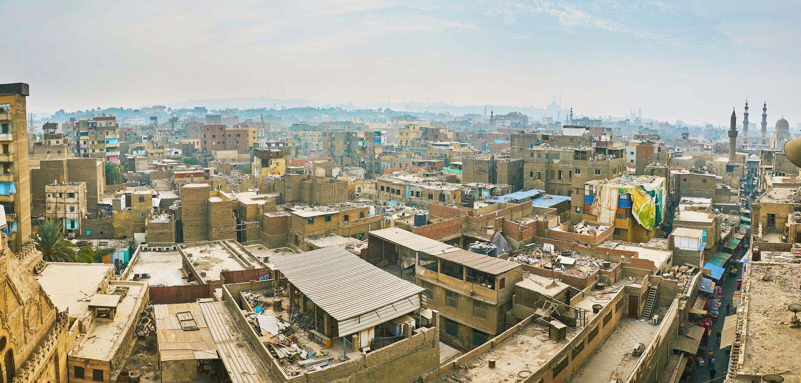 Overlook Islamic Cairo, Egypt. Panorama from the minaret of Al-Ghuri Mosque-Madrasa: the forest of old slums, covered with dust and the medieval minarets, rising royalty free stock images