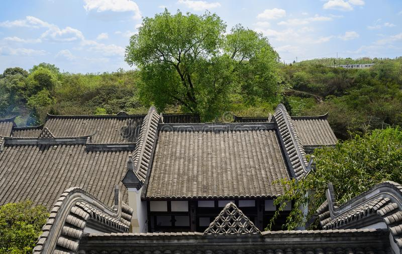 Overlook to Chinese traditional houses in sunny spring afternoon. The overlook to Chinese traditional buildings in sunny spring afternoon,Wufeng town,Chengdu stock image