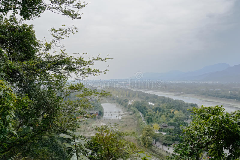 Overlook to riverside landscape in cloudy and foggy winter after stock photography