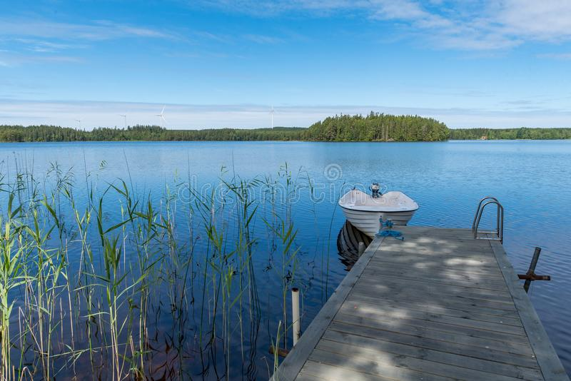 Overlooking a boat jetty and a lake royalty free stock images