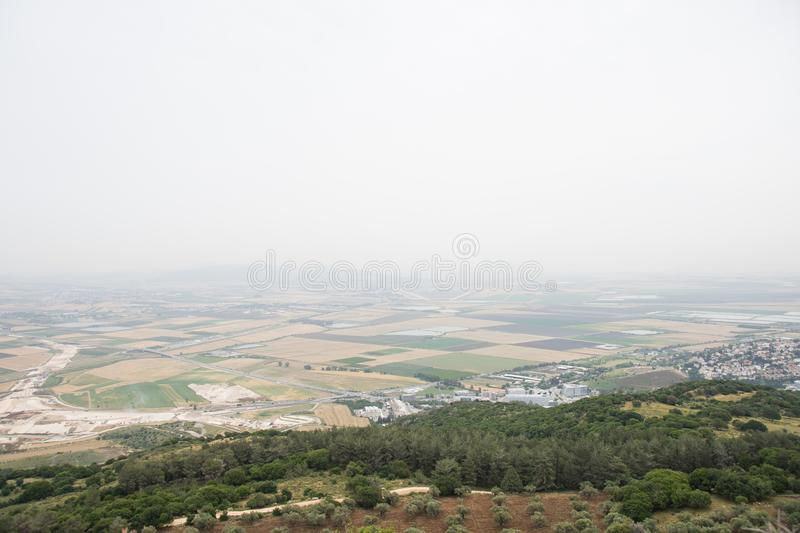 Valley of Armageddon. Overlooking landscape of Valley of Armageddon where farmers tend to farm stock photography