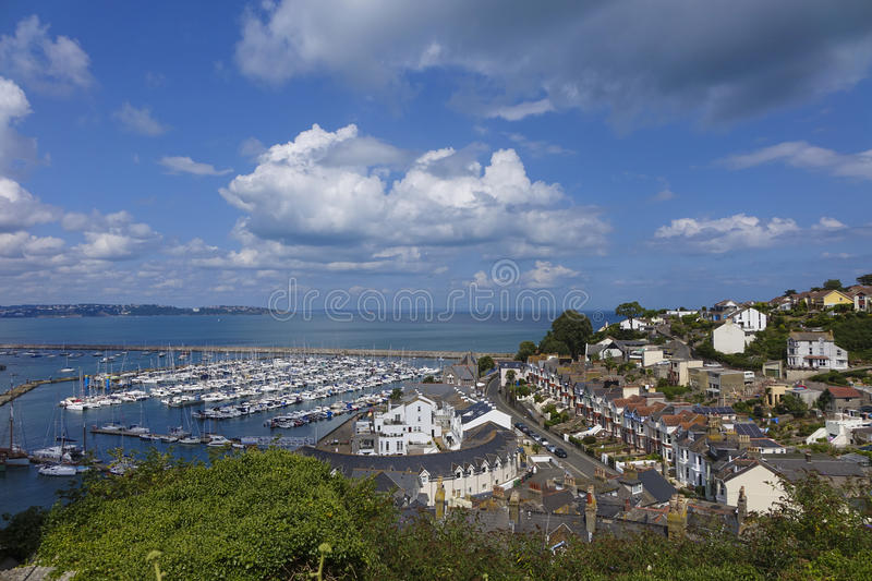 Overlooking outer harbor harbour Brixham Torbay Devon. UK with blue sky and white cloads stock image