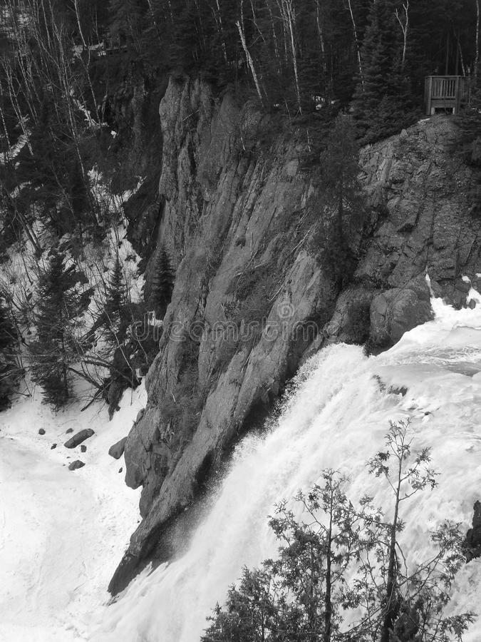 Overlooking waterfall in black and white stock photo