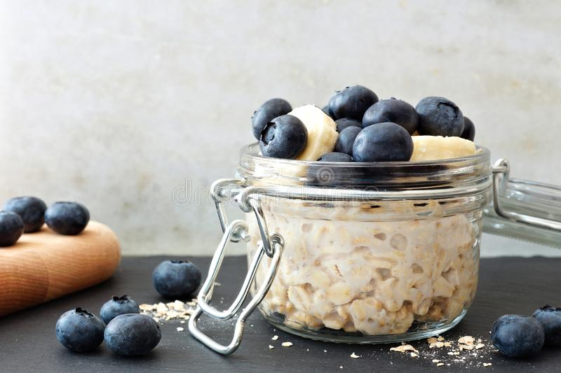 Overnight oats with blueberries and bananas, with white and black background stock image