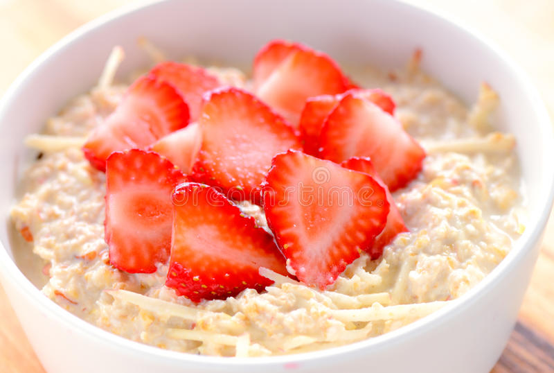 Overnight Oats. Healthy breakfast acai bowl with oats,muesli cereal,strawberries,green apple royalty free stock photos