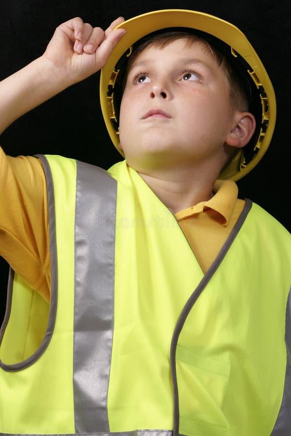 Overseeing Progress. Foreman looking skyward, oversees site progress stock photo