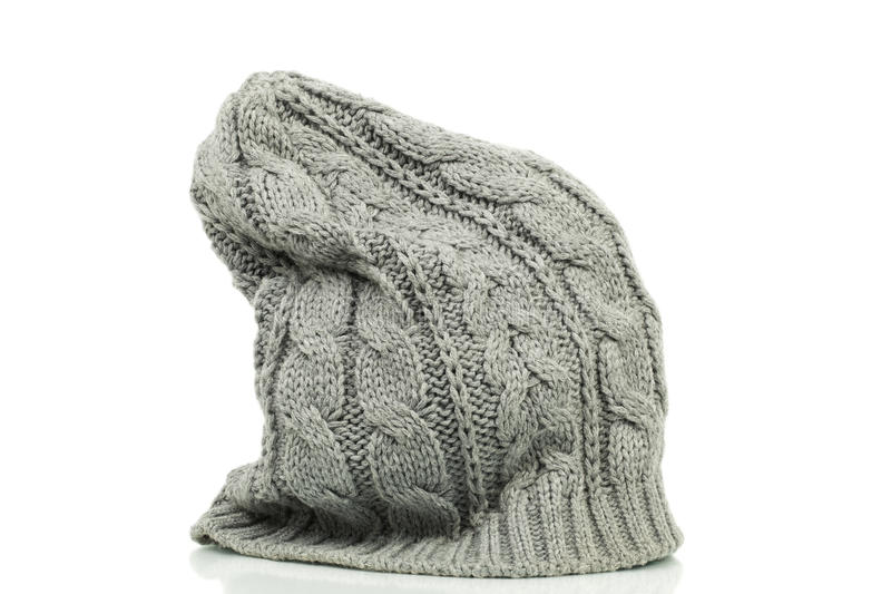 Oversized beanie in grey color. On a white background royalty free stock images
