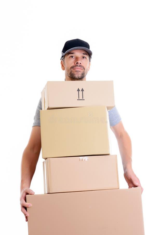 Overspannen brievenbesteller met pakketten royalty-vrije stock afbeelding