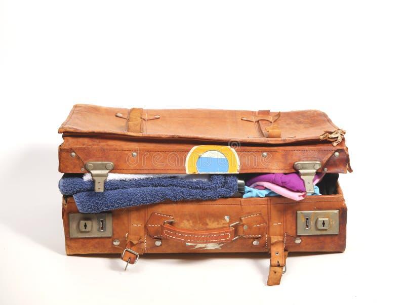 Oversuffed suitcase stock photo