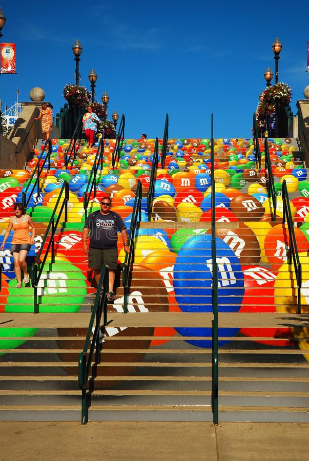 Overt outdoor advertising. The stairs leading to an amusement park also double as an advertisement for candy stock image