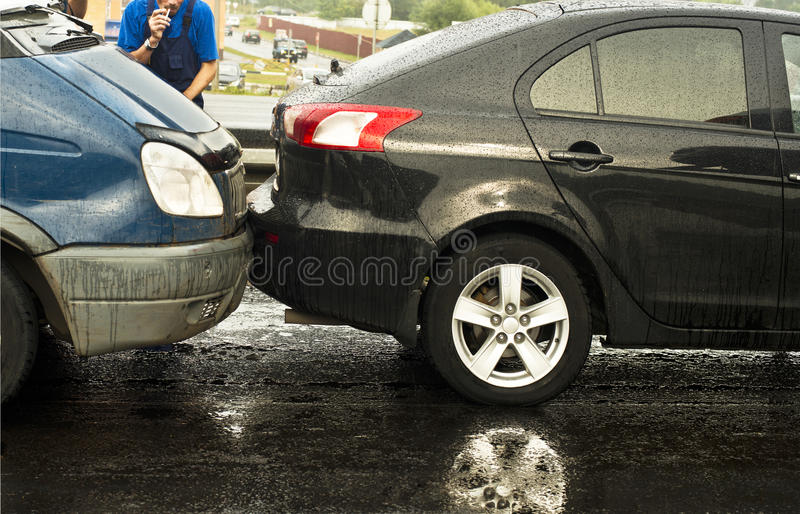 Overtaked. Car accident on rainy road surface stock photo