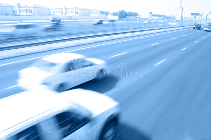 Overtaking. Movement of vehicles on highway stock images